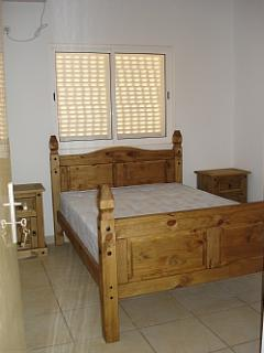 Double bedroom with air con and lots of storage space