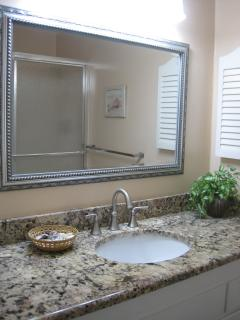 MASTER BATHROOM WITH RAIN SHOWER, SEAT IN SHOWER, AND GRANITE COUNTERS