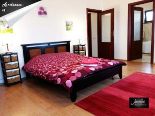 Master Bedroom with extra sofa bed, direct access to back garden & en-suite bathroom