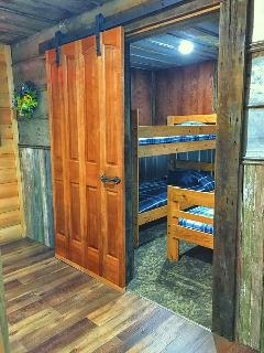 Bedroom with bunk bed and 2 twin beds