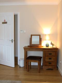 Family or Twin Room with dressing table offering a hairdryer and USB charging sockets.