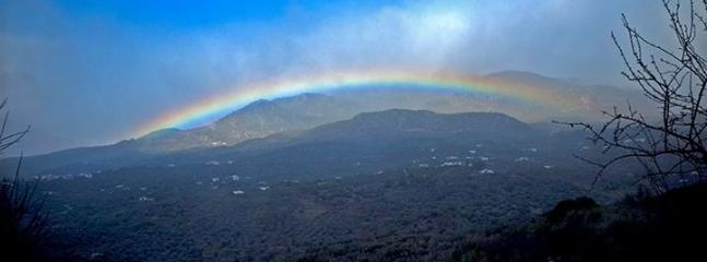 Rainbow over 7000 ft  Mount Maroma opposite house