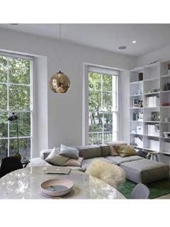 Spectacularly luminous living room with dramatic floor-to-ceiling windows and doors to large balcony