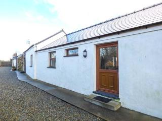 PEMBROKE HAVEN COTTAGE, single-storey cottage, field views, woodburner, garden