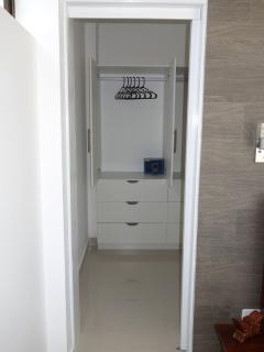 Walk-in closet with safe deposit box.
