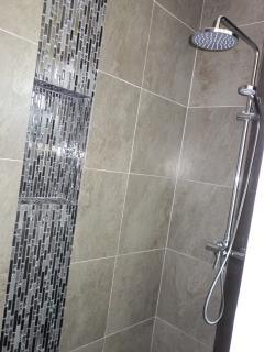 Tiled shower walls.