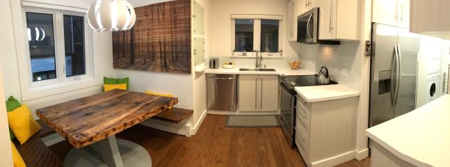 Modern kitchen fully equipped to cook.  Cozy table nook to sit and eat.