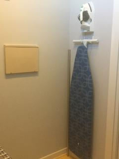 Iron and ironing board located in master closet