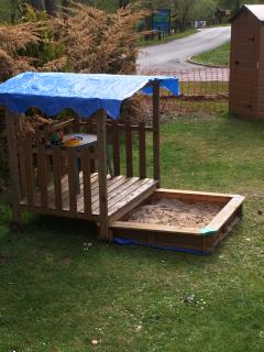 Kids sand pit and toys in large side plot