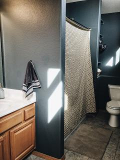 Private Bathroom for upstairs bunk room features a full bath.