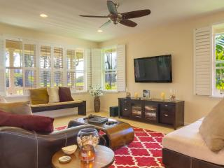OUR SPACIOUS LIVING ROOM WITH A VIEW AND PLANTATION SHUTTERS
