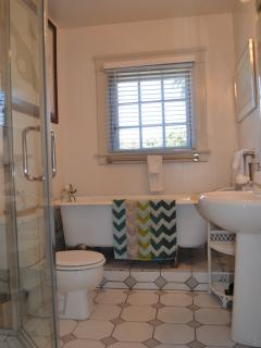Bathroom with the shower and the claw foot  tub