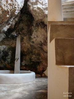 'La Cueva' - the big bathroom - integrated in the cave (stairs to upper room and rock terrace).