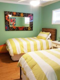 2nd bedroom with two twin size beds and a pull out trundle