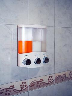 soap, shampoo and conditioner dispensers in each shower