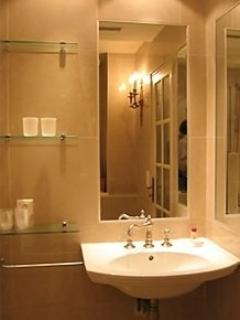 Bathroom, renovated, porcelain walls, full tub and american shower