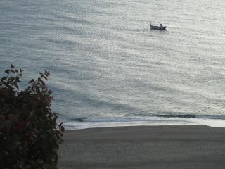 Typical wooden Spanish fishing boat as seen from main terrace.The fishing fleet go out most nights.