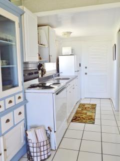 Galley kitchen and entry door.