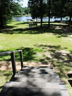 Step down from the deck...a private yard...steps to the lake...