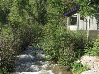 The Rio Hondo River running by our cabin where you can catch trout from the deck.