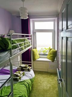 Bunk bed room with window seat and sea view