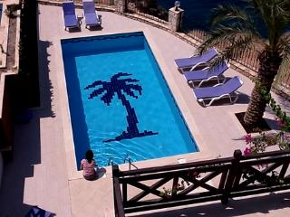 Your own 30m2 private pool and sun-bathing terrace with lounge chairs and shade umbrellas.