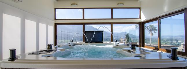 The Jacuzzi boasts a sound system and a retractable TV.