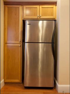 stainless steel appliance and lots of kitchen cabinetry.
