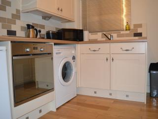 KItchen with cooker, microwave, fridge, washer, kettle, toaster