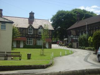 Wortley village Green with Wortley Mens Club to the right with Sky and BT Sport