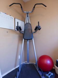 Part den with desk and printer, part fitness center with tower and dumbells