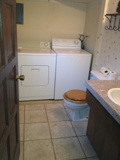 This half bath is on the same level as the kitchen / living / dining room.  Full size washer & dryer