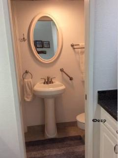 Bathroom pedestal sink and mirror with assist bar for toilet