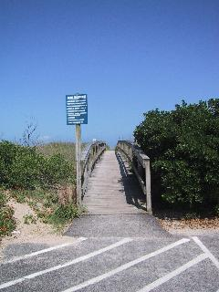 Wooden walkway to beach across the street from condo