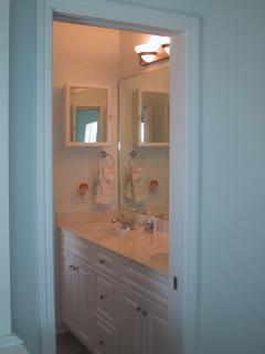 View into Jack and Jill Bath with dual vanities
