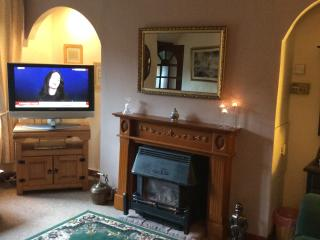 Cosy lounge with oak beams,a Living Flame Fire and period features Digital TV and Recorder