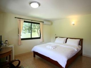 Located on the hill side, room features a private balcony with garden view.
