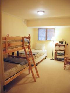 The fifth bedroom downstairs has a twin bunkbed and a separate twin bed too