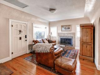 The interior is nicely appointed with tasteful furnishings and original hardwood floors.