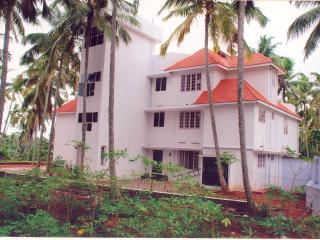 Indeevaram Apartment R1 with sea view over trees., Kovalam