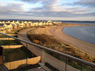 The view East from the private balcony. Enjoy the quiet beach and coastal walk.