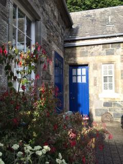 The entrance into the courtyard, always filled with flowers.