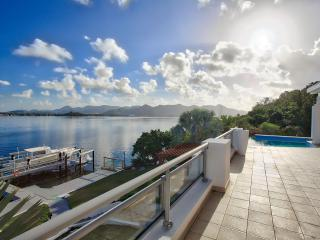 AMARYLLIS... Modern waterfront villa with boat dock and full AC, in gated community close to Mullet Bay beach, Maho
