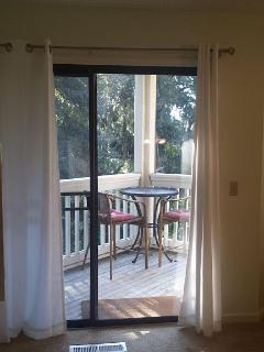 Enjoy your coffee or wine at  bistro table & chairs overlooking nature views