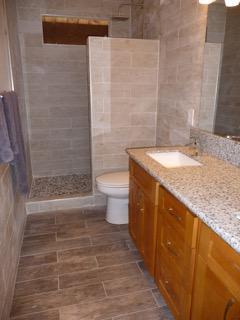 Bathroom w/ double vanity, walk-in rain shower, granite counter