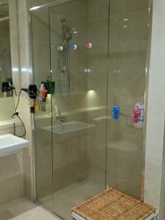 luxurious marble tiled shower with two shower heads