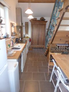 The kitchen seats four people & has all the facilities you need for your holiday. Door to garden.