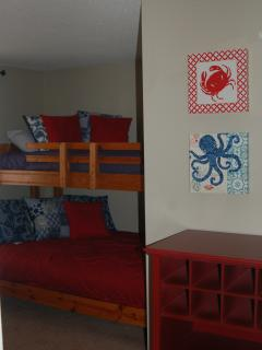 bunkroom with twin over full beds with access to shared hall bathroom.