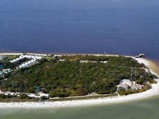 Another aerial view of Lighthouse Point Condos (white roofs). The fishing pier is on the right.