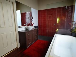 The bathroom consists of a large bath tub and a  walk in shower.